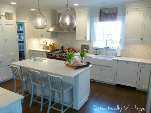 Classic white kitchen with tons of unique and fun touches eclecticallyvintage.com