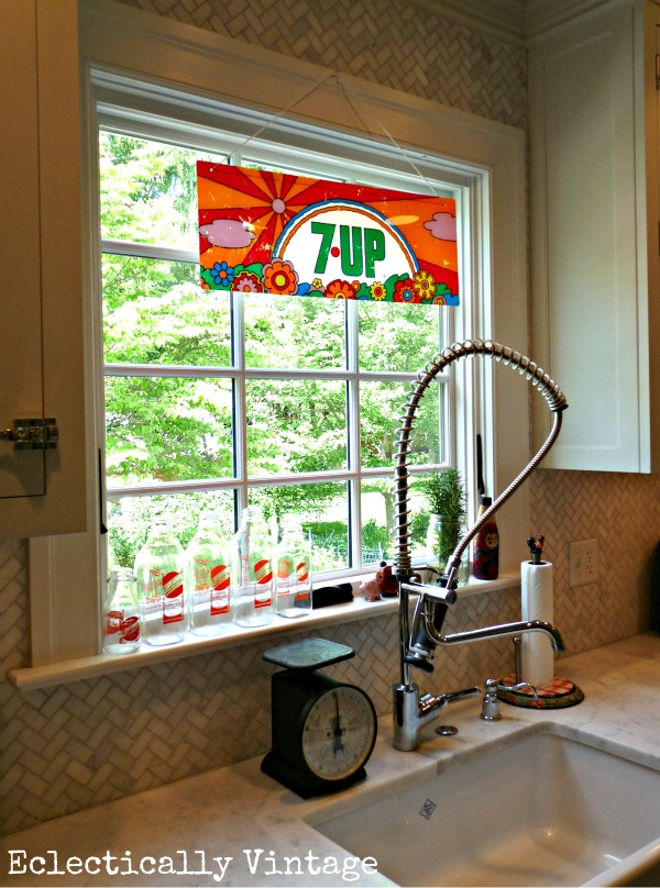 Vintage Peter Max 7Up sign in this beautiful white kitchen kellyelko.com