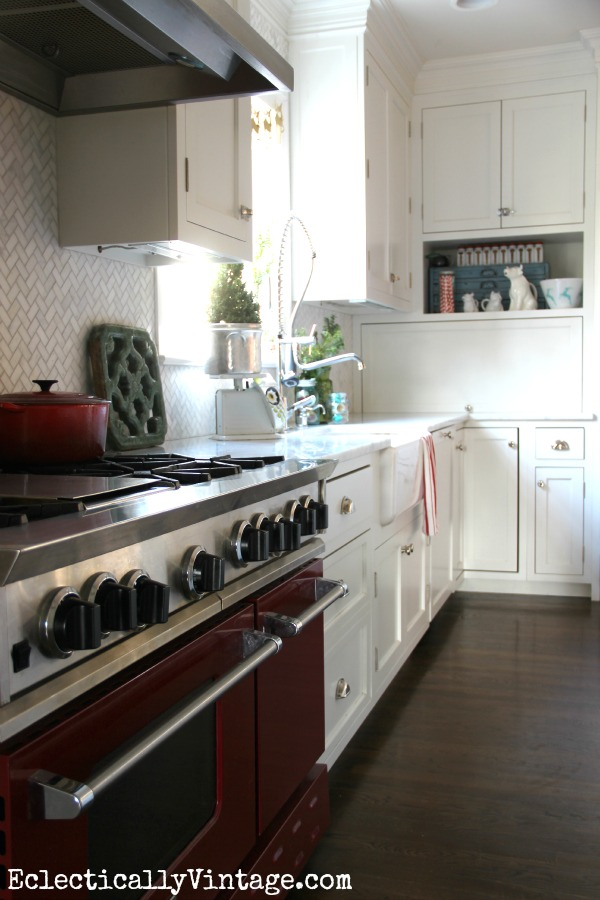Beautiful white kitchen with a red stove! kellyelko.com