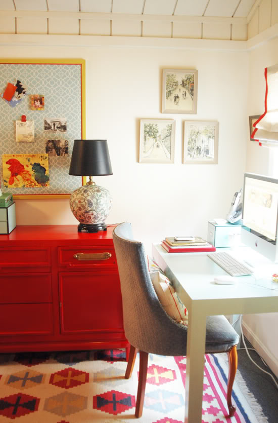 This is an amazing home office - love the red console for storage