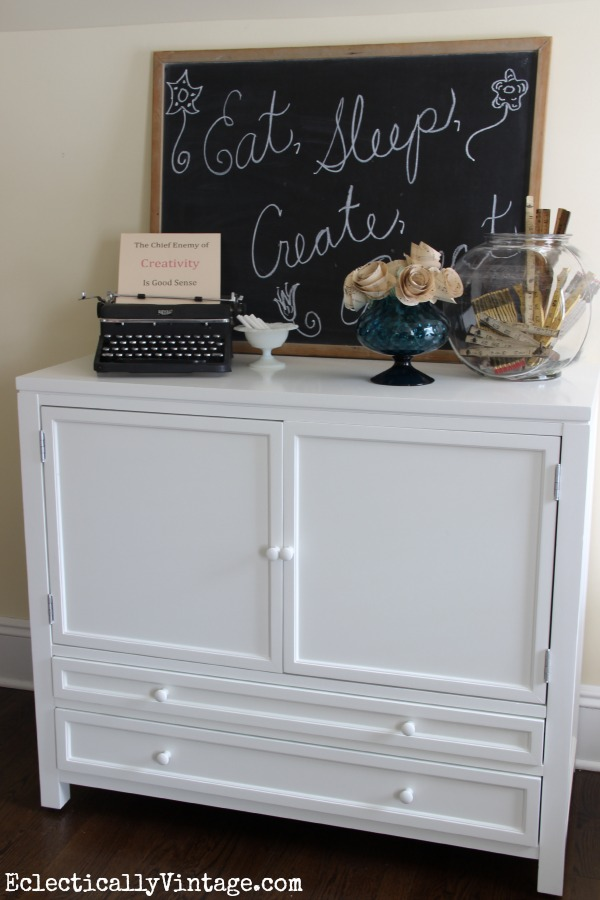 Love this light and bright craft room - so much storage! kellyelko.com