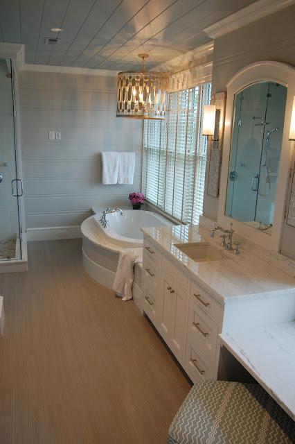 Tranquil master bathroom - love the blue plank ceiling kellyelko.com