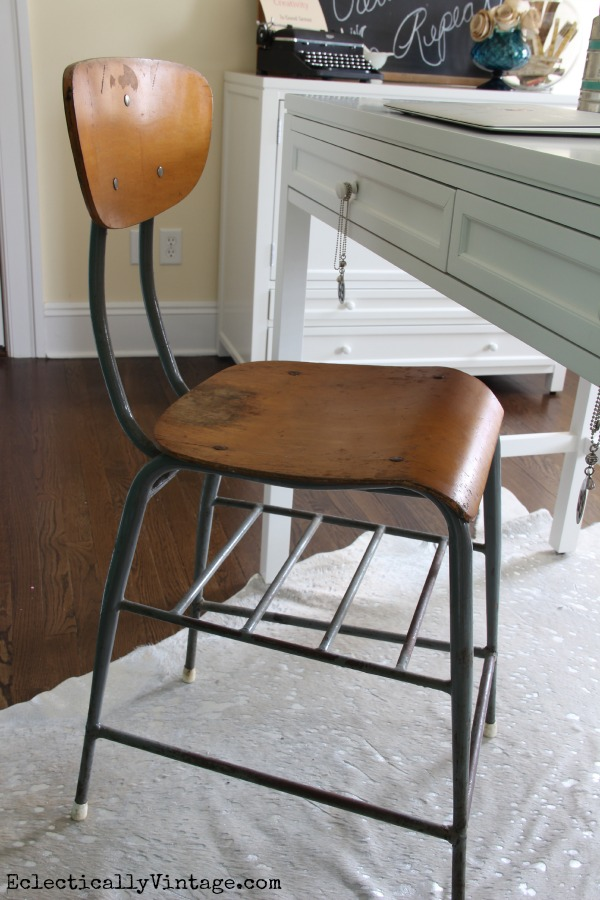 Love the industrial stool in this craft room - perfect mix of old and new! eclecticallyvintage.com