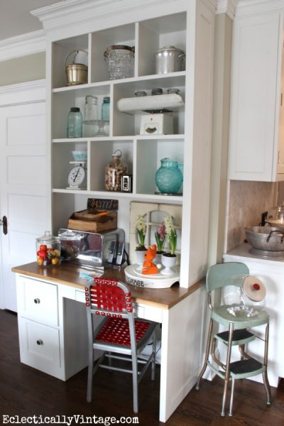 Open kitchen cubbies are perfect for display! eclecticallyvintage.com
