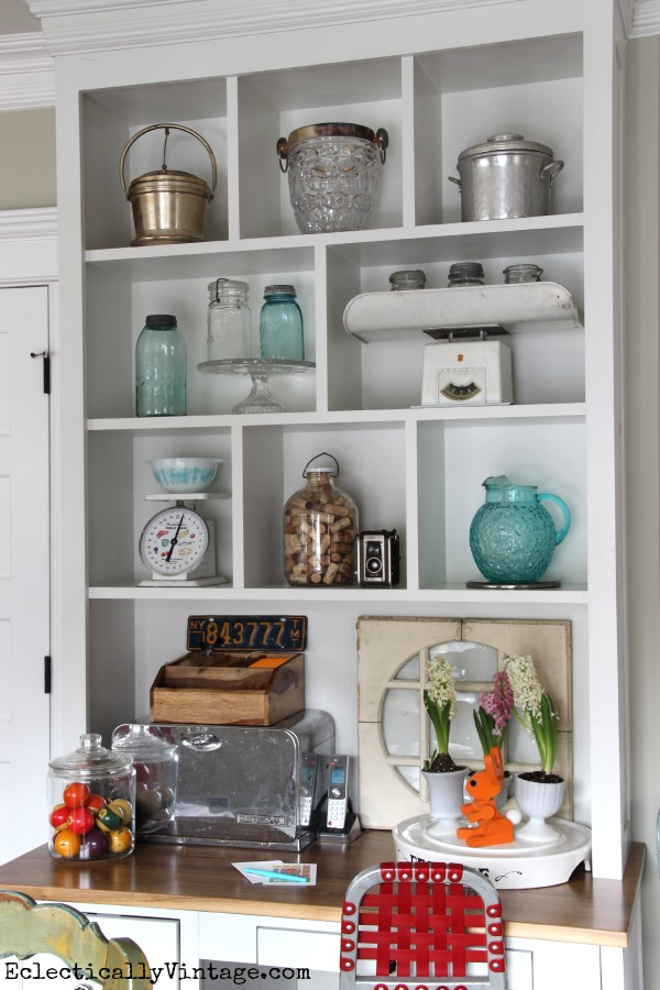 Styling open shelves - love these fun collections! kellyelko.com