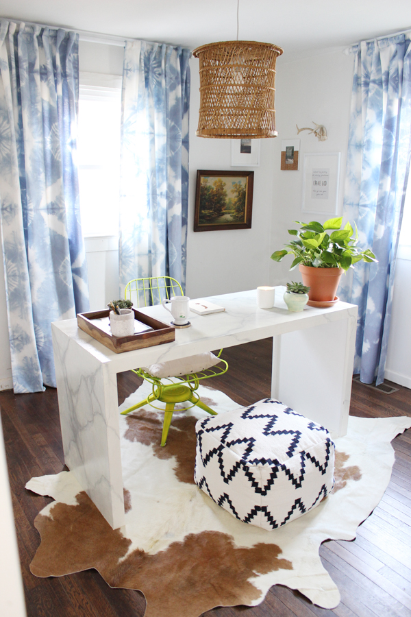 Chic home office with a DIY desk and curtains kellyelko.com