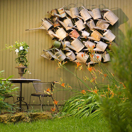 watering can wall very cool garden art kellyelkocom - Unique Garden Ideas Decorating
