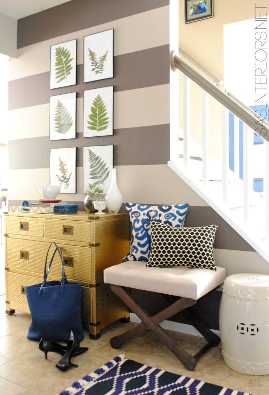 Striped wall foyer - love the gold chest of drawers kellyelko.com
