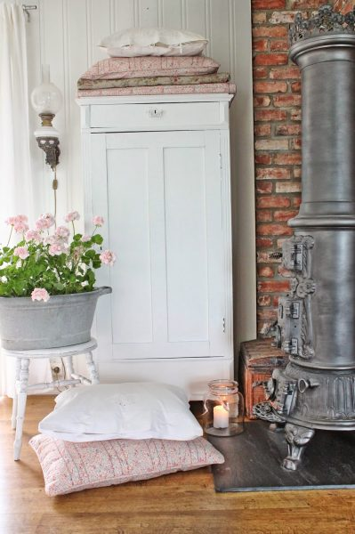 Love this exposed brick wall in this cottage tour kellyelko.com
