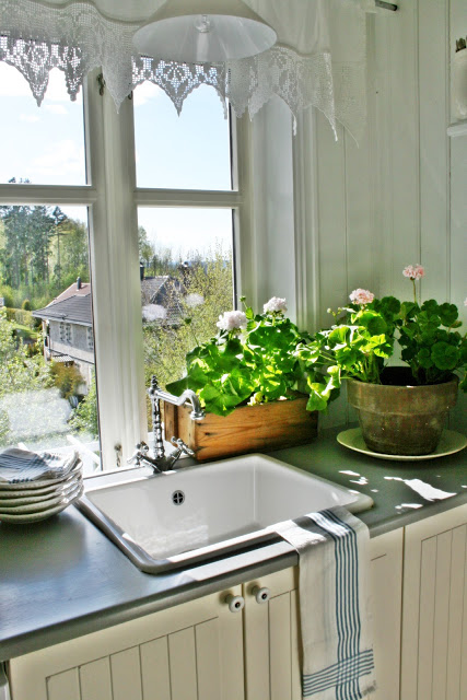 What a view from this farmhouse white kitchen eclecticallyvintage.com