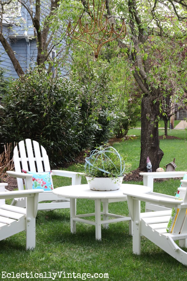 Love this adirondack chair set - and the chandelier hanging from the tree! eclecticallyvintage.com