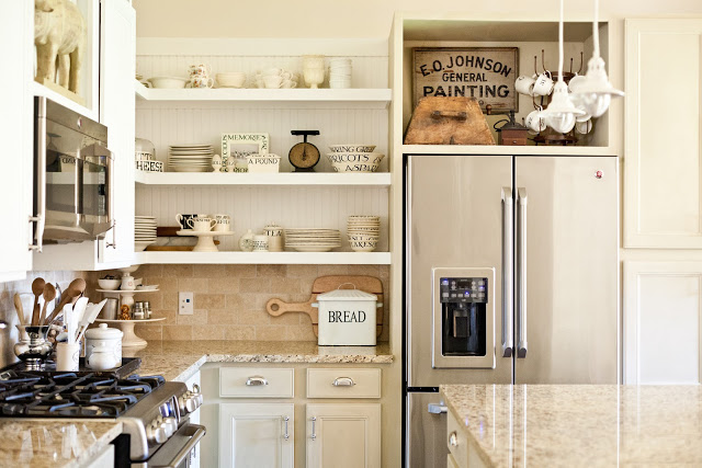 Little Cottage on the Pond home tour - love the open kitchen shelves kellyelko.com