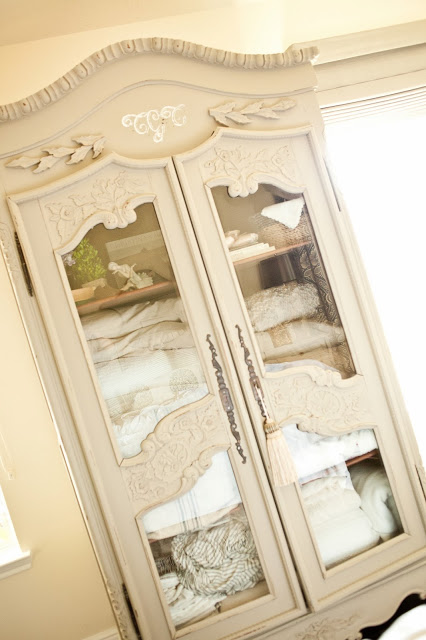 Love the glass panels on this armoire kellyelko.com