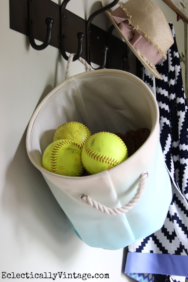 Great storage ideas in this small mudroom - hang a canvas basket on a coat rack! kellyelko.com