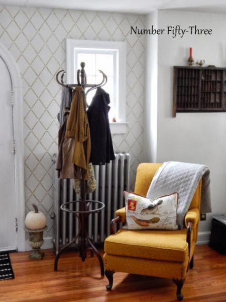Beautiful vintage filled home - love the stenciled wall kellyelko.com