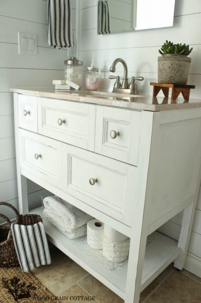Love this white bathroom console eclecticallyvintage.com