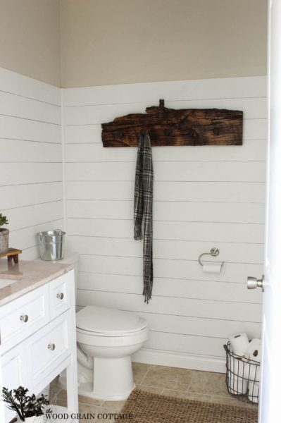 Plank wall bathroom with rustic towel holder eclecticallyvintage.com