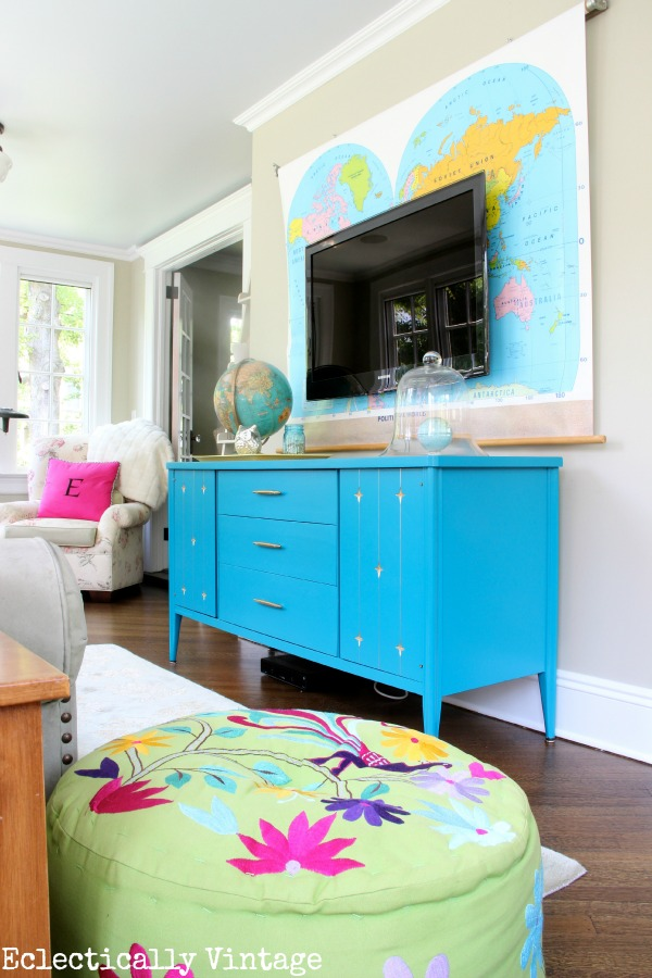 Colorful Sunroom - love the map behind the tv!  kellyelko.com