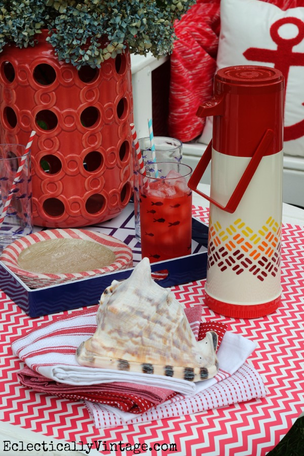 Love the huge red candleholder used for flowers! kellyelko.com