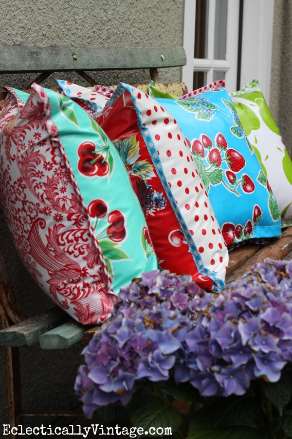 Oilcloth pillows - perfect for outdoors! LOVE the fun prints! eclecticallyvintage.com