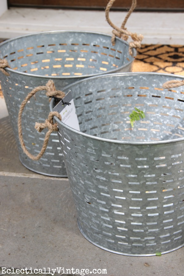 Knock off olive buckets - she used them as hanging planters and they look amazing! eclecticallyvintage.com