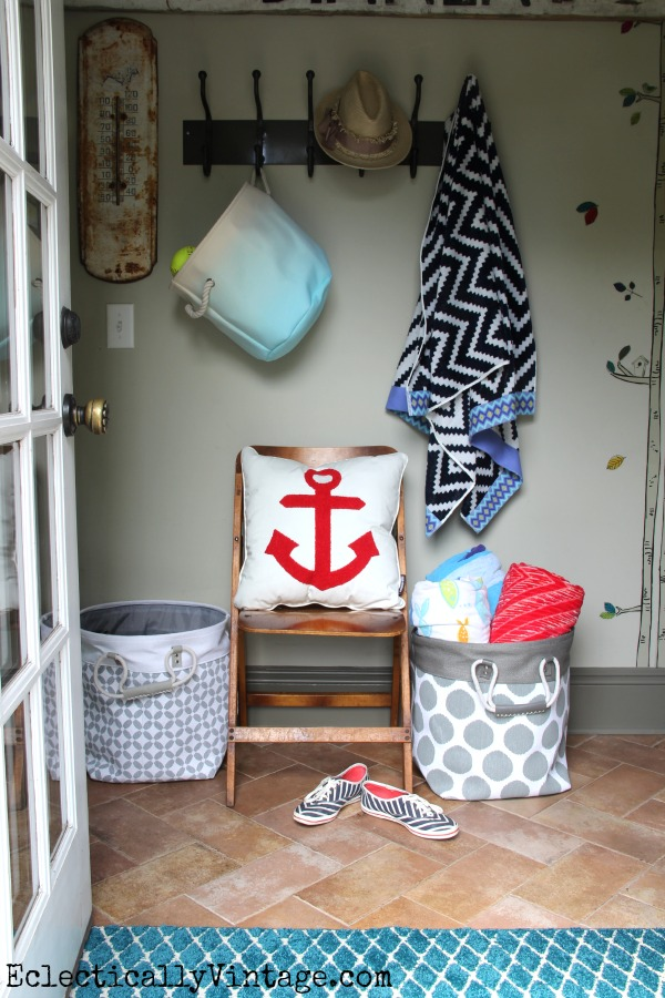 Cute summer mudroom - great storage ideas! kellyelko.com