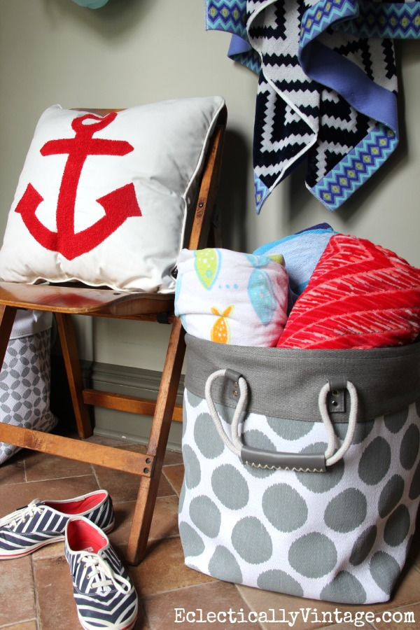 What a cute summer mudroom with great storage ideas - and I love that anchor pillow! kellyelko.com