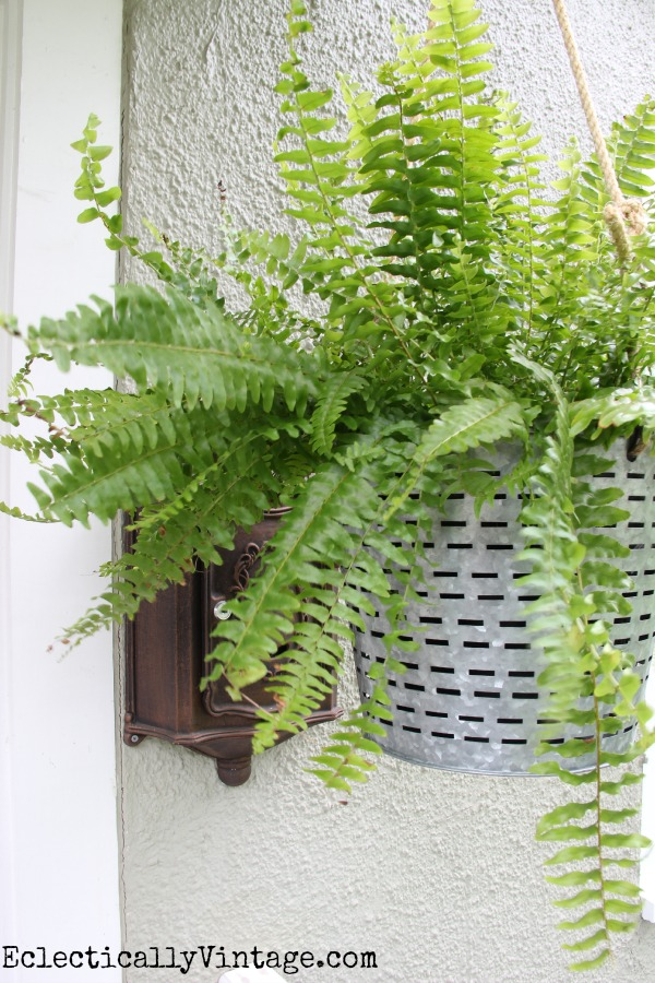 What a unique hanging planter idea!  Looks great on this porch kellyelko.com