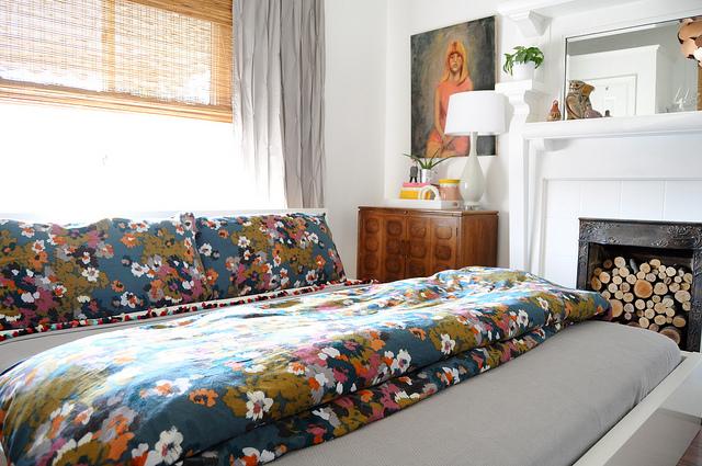 Colorful bedroom - beautiful fireplace! kellyelko.com