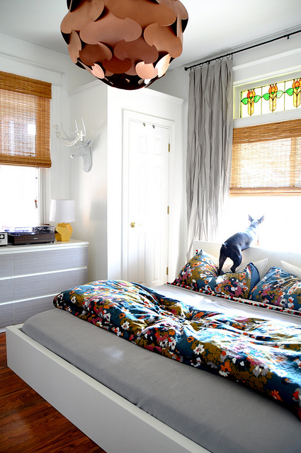 Colorful bedroom - love the chandelier! kellyelko.com