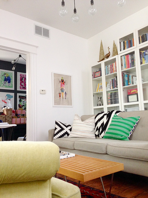 Modern and cozy living room - love the bookcase kellyelko.com