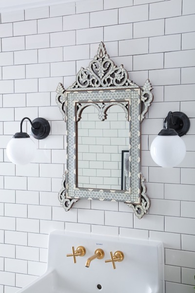 Love the wall of subway tile and the Moroccan mirror kellyelko.com