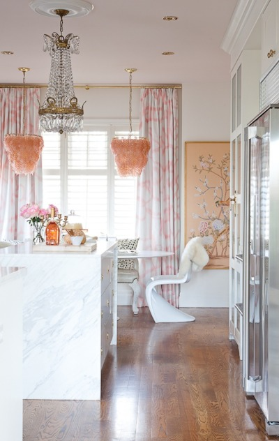 Amazing white kitchen with pale pink accents - love the twin pink chandeliers kellyelko.com