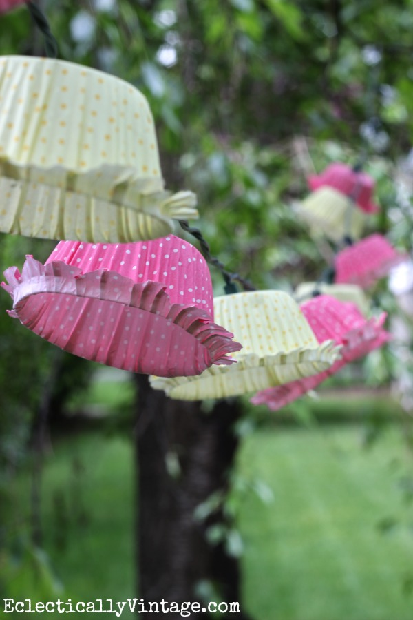Make cupcake liner string lights - these look amazing strung from the trees! kellyelko.com
