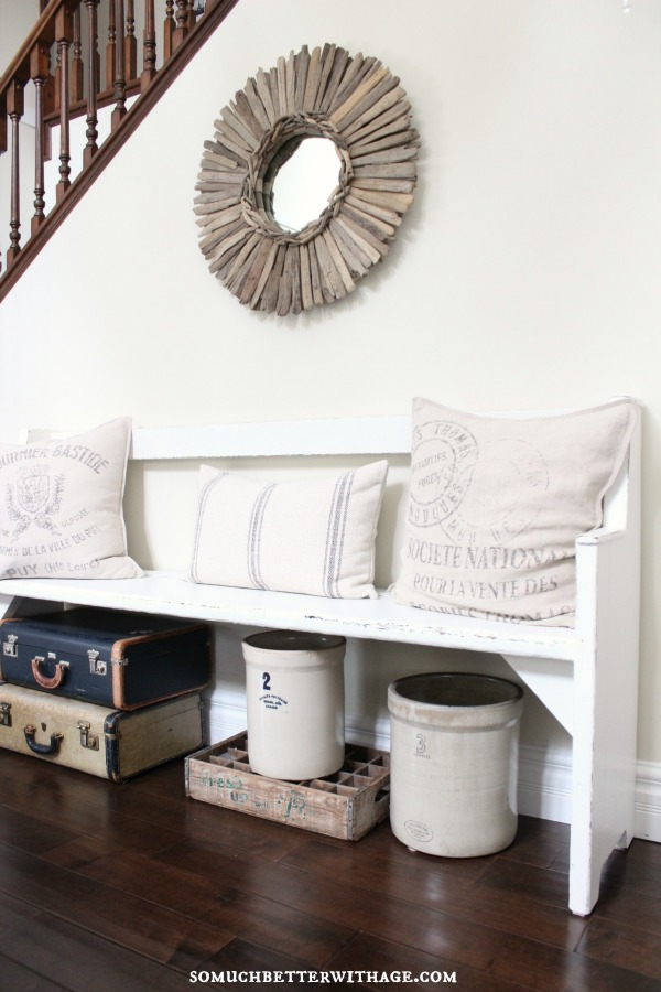 Beautiful entry - love the bench and driftwood mirror kellyelko.com