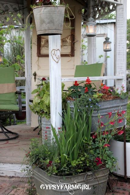 Gorgeous farmhouse garden tour - love the painted floor in the gazebo kellyelko.com