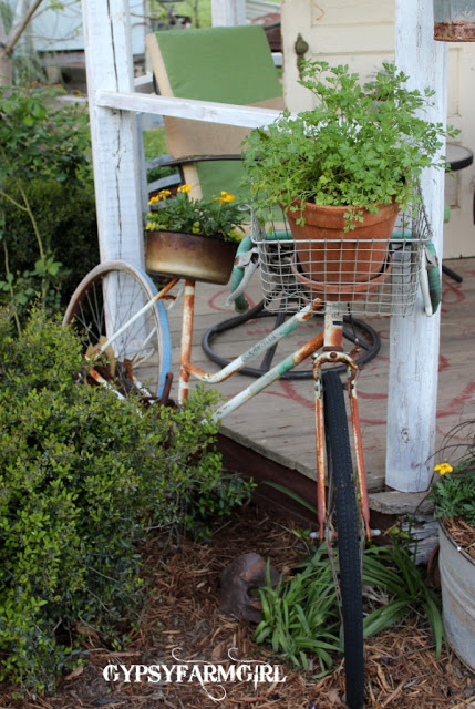 Love this old gazebo and bike planter in the center of a junk garden kellyelko.com