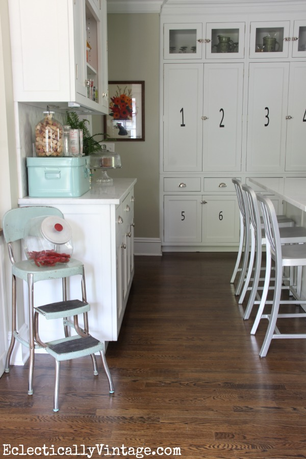 White farmhouse kitchen - love the pantry behind those numbered cabinets! eclecticallyvintage.com