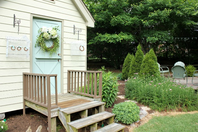 Beautiful backyard tour including this cute little craft shed eclecticallyvintage.com