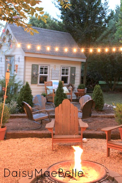 Love this fire pit and the shed turned craft room! kellyelko.com