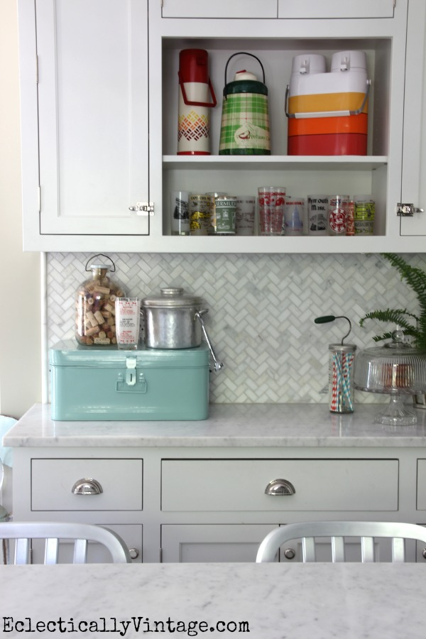 Love the carrara marble backsplash and the colorful vintage collections! eclecticallyvintage.com