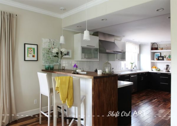 Love the layout of this kitchen and the peninsula with the wood wrapping around the side kellyelko.com