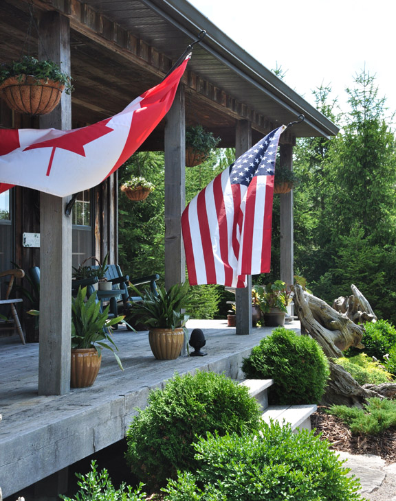 Porch flags and a charming garden tour eclecticallyvintage.com