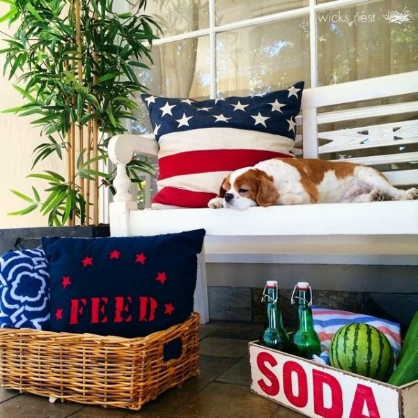 Patriotic red, white and blue porch - love the flag pillow kellyelko.com