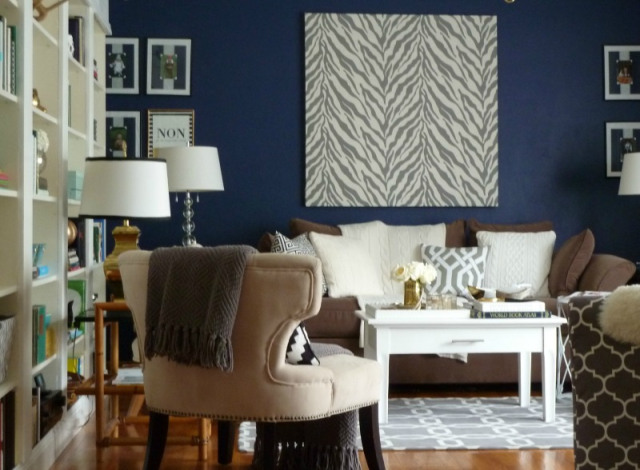 Cozy living room - love the rich blue wall color kellyelko.com
