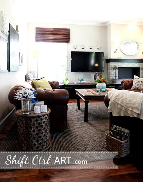 Cozy living room - love the tufted leather sofa and the rustic coffee table kellyelko.com