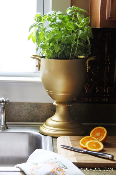 An old lamp becomes this fun trophy planter kellyelko.com