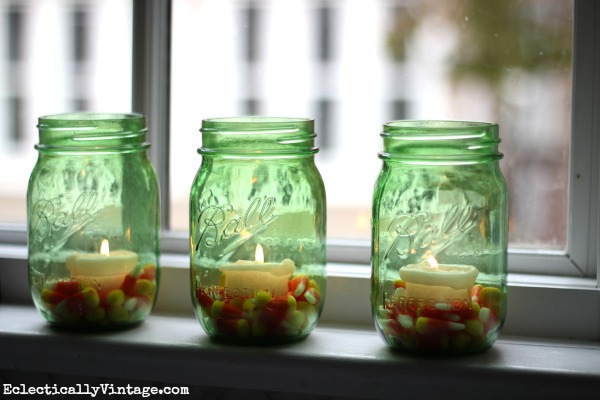 Super cute idea - candy corn mason jar candles kellyelko.com #EclecticallyFall