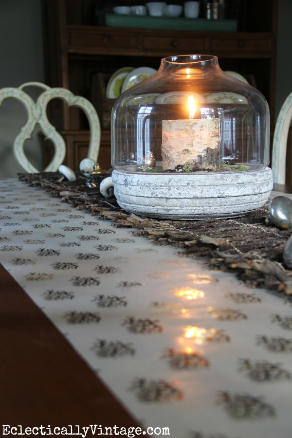 Love this table - the layering of the paper, twigs and terrarium kellyelko.com #EclecticallyFall