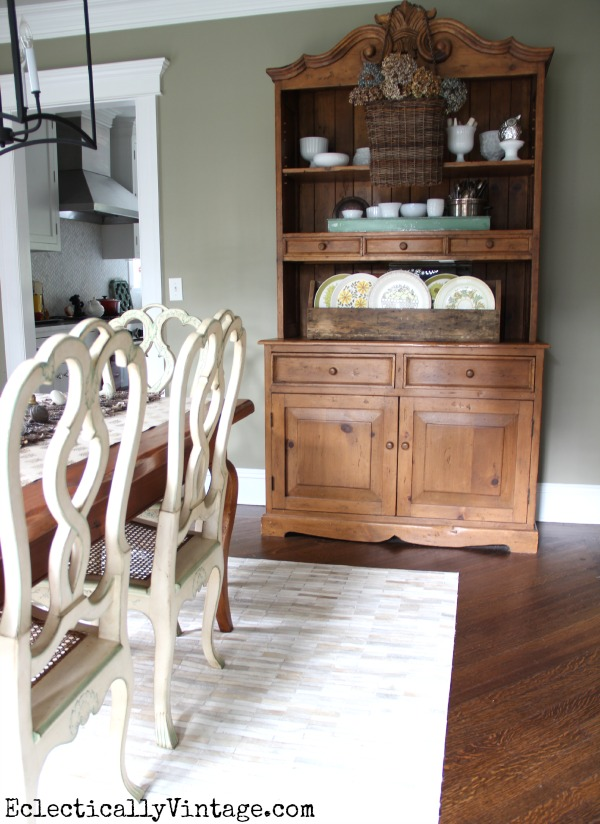 Love this dining room hutch filled with beautiful collections eclecticallyvintage.com #EclecticallyFall